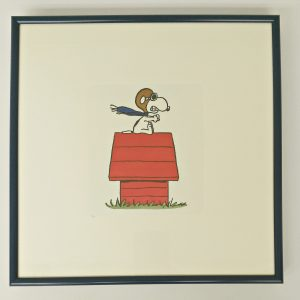 Framed Snoopy prints to raise funds for Loyola Prep school in Shreveport.